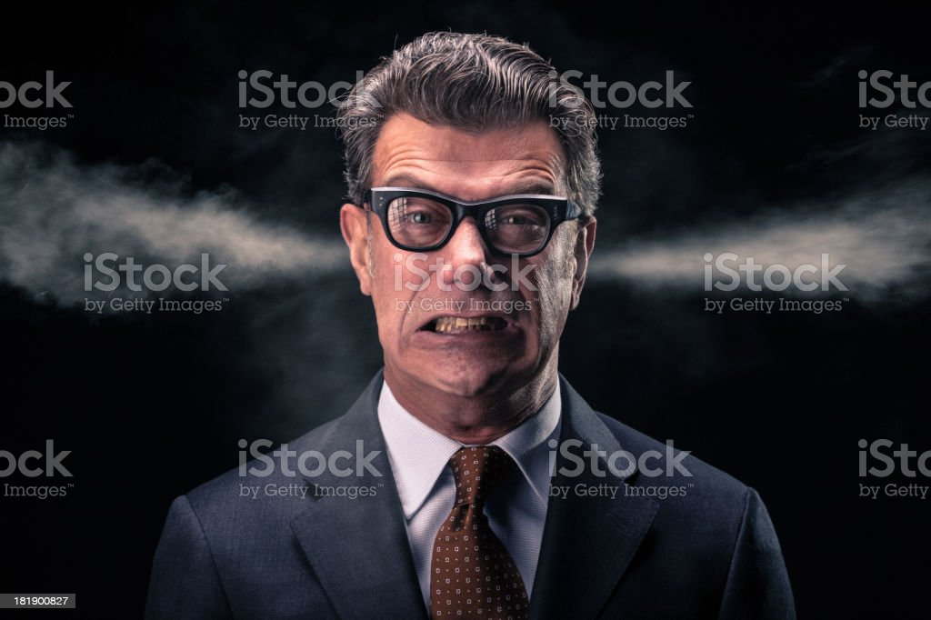 Stressed Businessman with Steam Jets Blowing out of his Ears stock photo