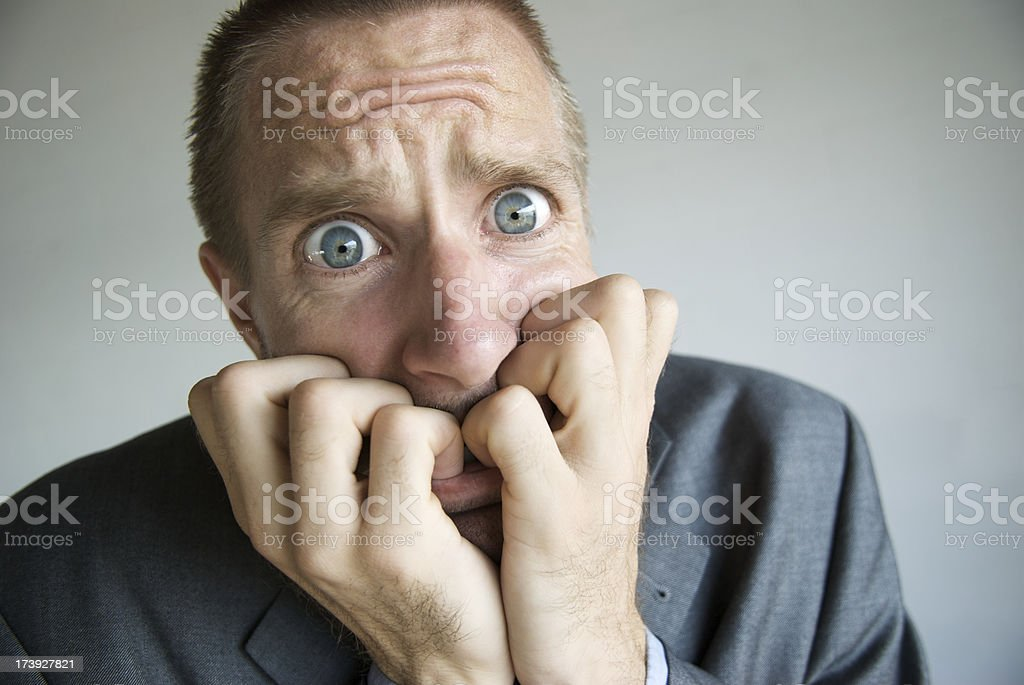 Stressed Businessman with Wide Eyes Looking Frightened stock photo