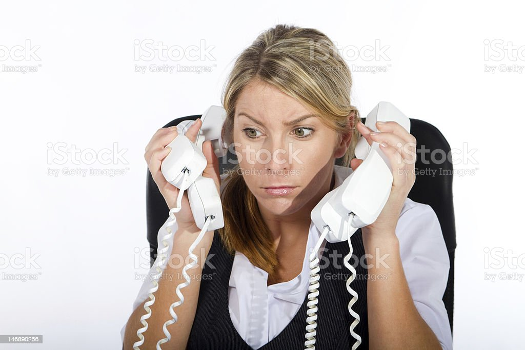 stressed businesswoman dealing with phone calls royalty-free stock photo