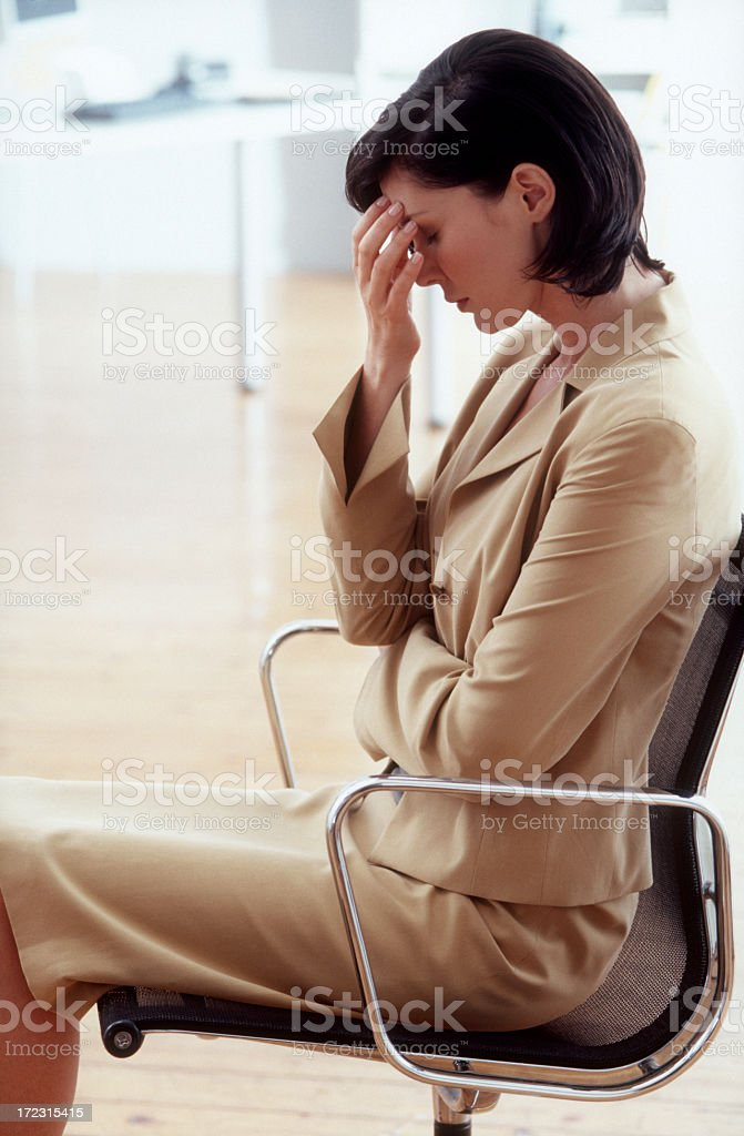 Stressed businesswoman is suffering from headaches royalty-free stock photo