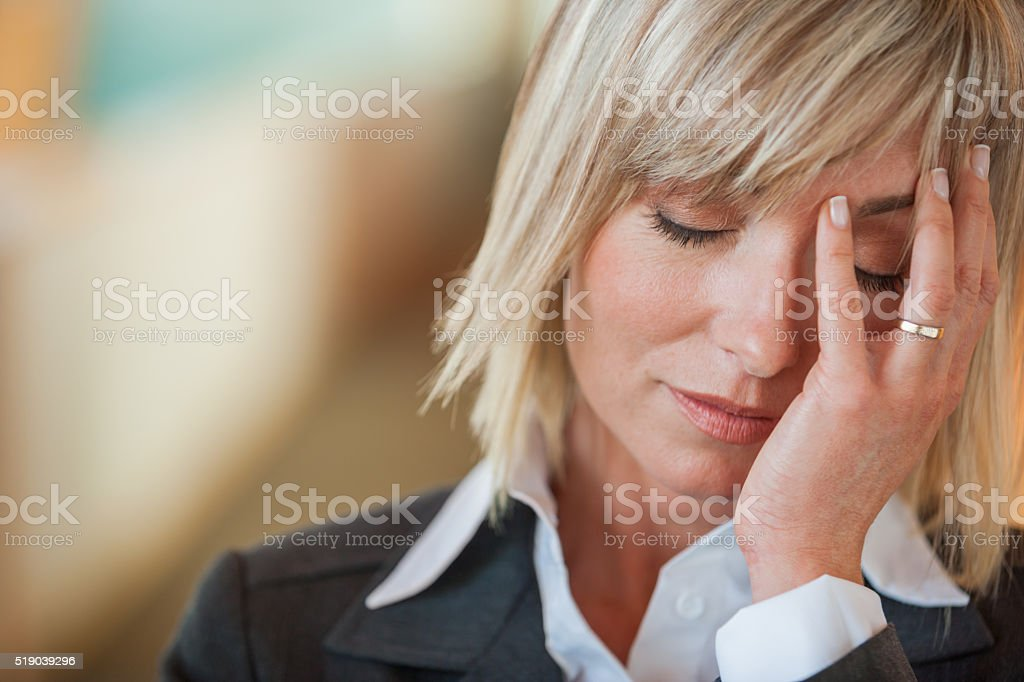 Stressed businesswoman stock photo