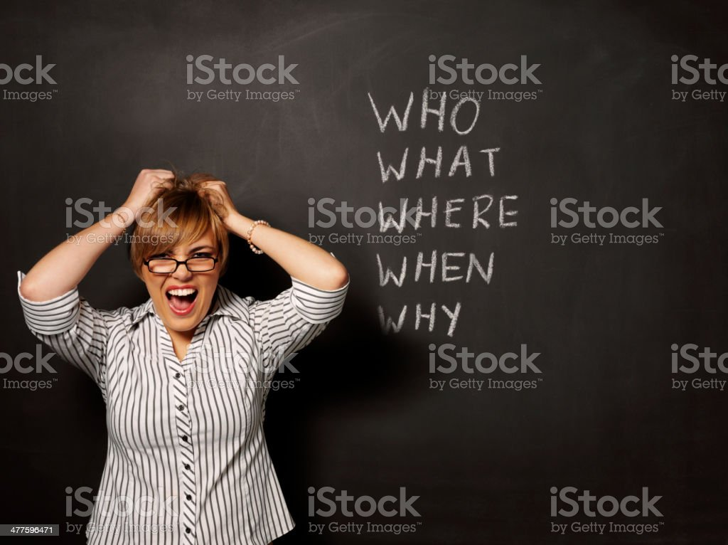 Stressed Businesswomen with Who What Where When and Why royalty-free stock photo