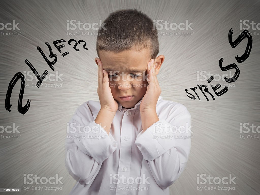 Stressed child, having headache stock photo