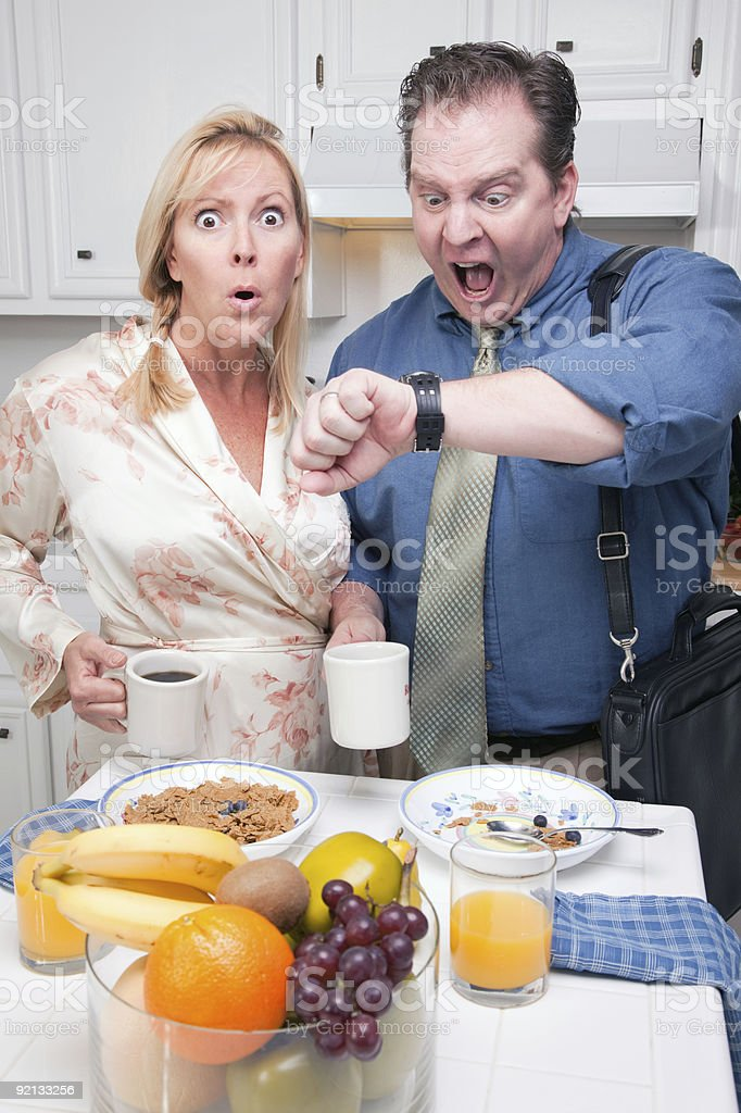Stressed Couple in Kitchen Late for Work royalty-free stock photo