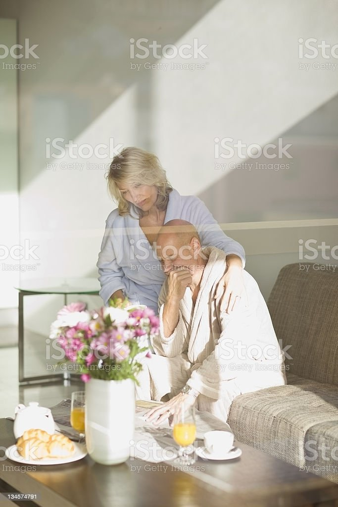 Stressed couple reading newspaper royalty-free stock photo