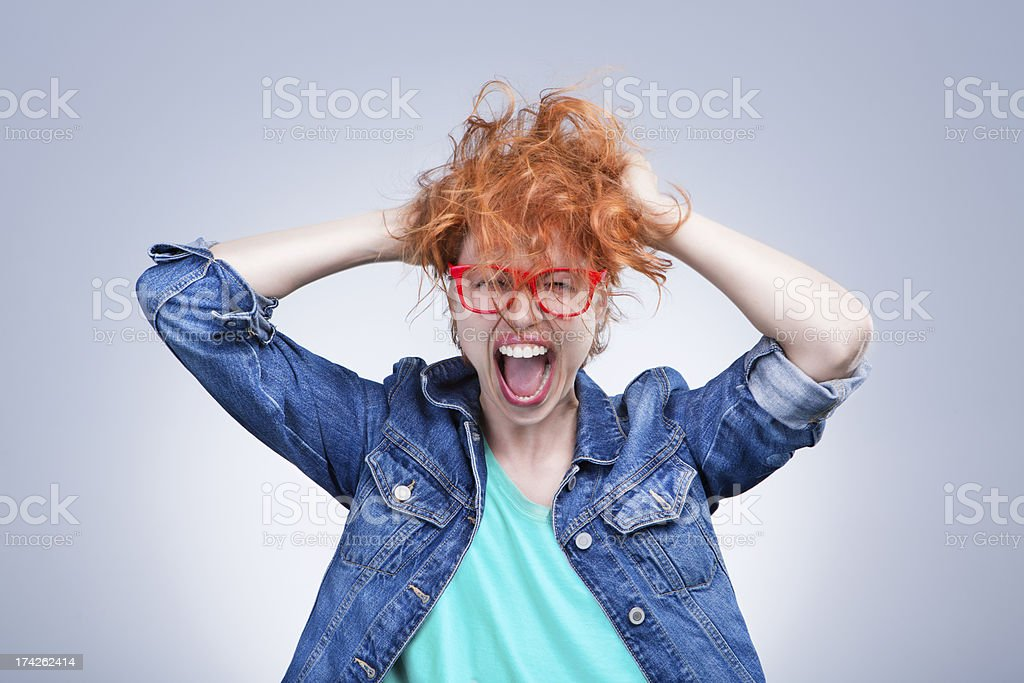 Stressed girl is screaming stock photo
