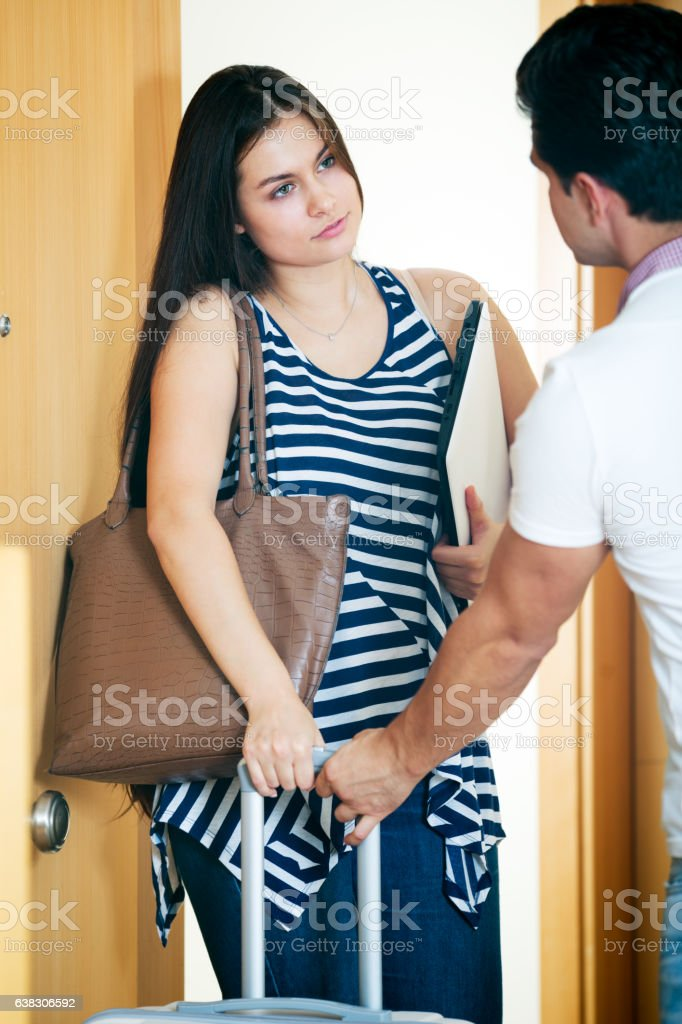 Stressed husband trying to stop girl stock photo