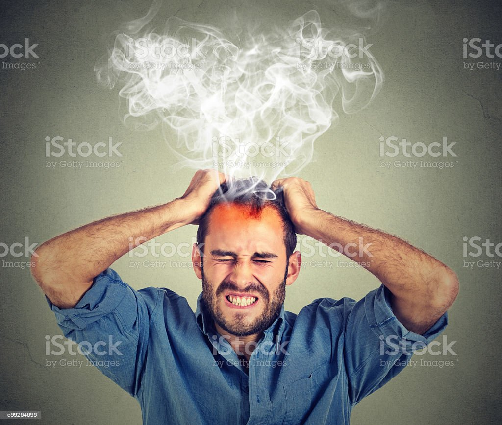 Stressed man having headache steam coming up stock photo