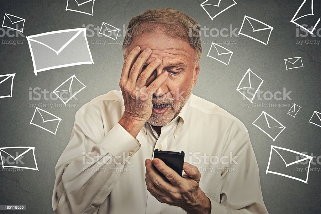 stressed man holding cellphone shocked with message received stock photo