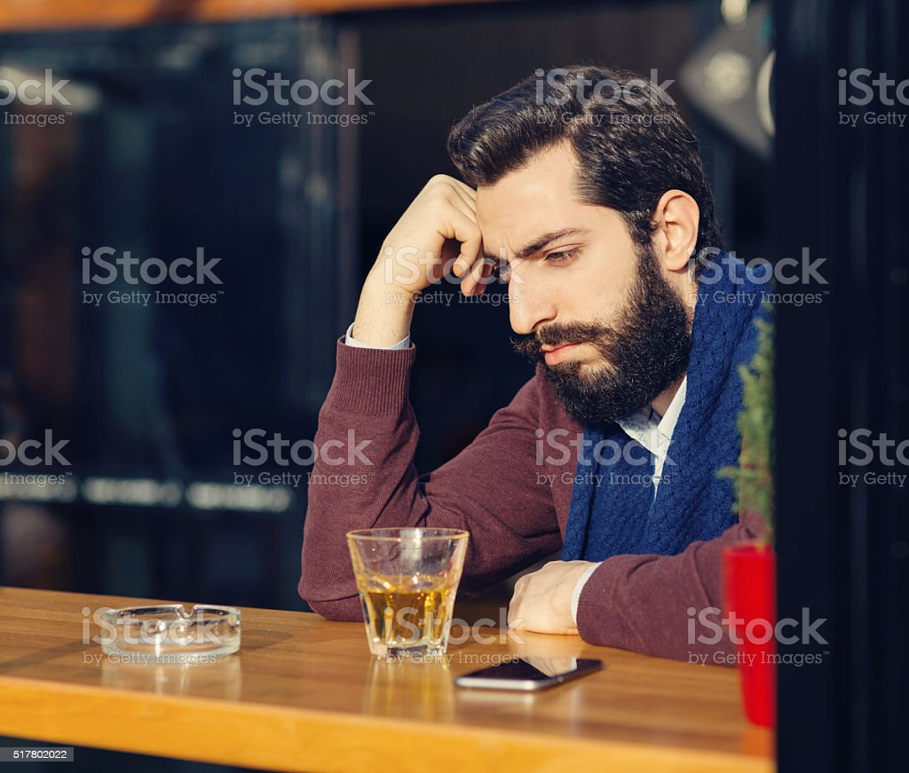 Stressed man in a bar stock photo