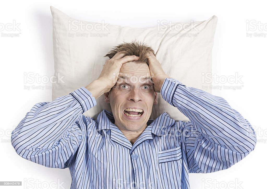 Stressed man in bed cant sleep stock photo