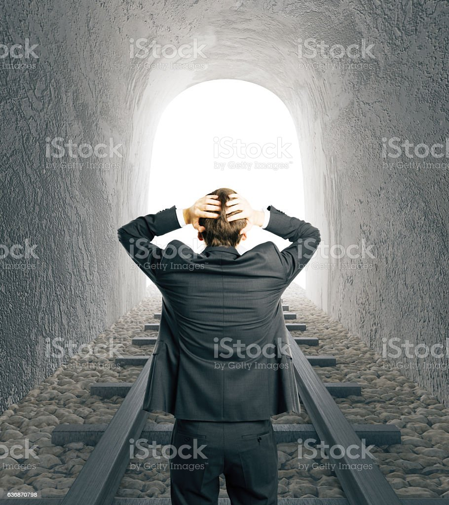 Stressed man in railway tunnel stock photo