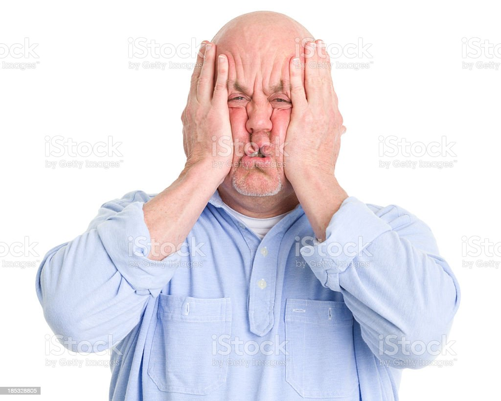 Stressed Man Squishes Face in Hands royalty-free stock photo