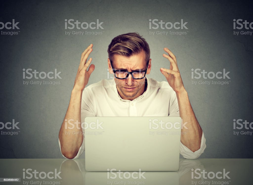 Stressed man working on computer. stock photo
