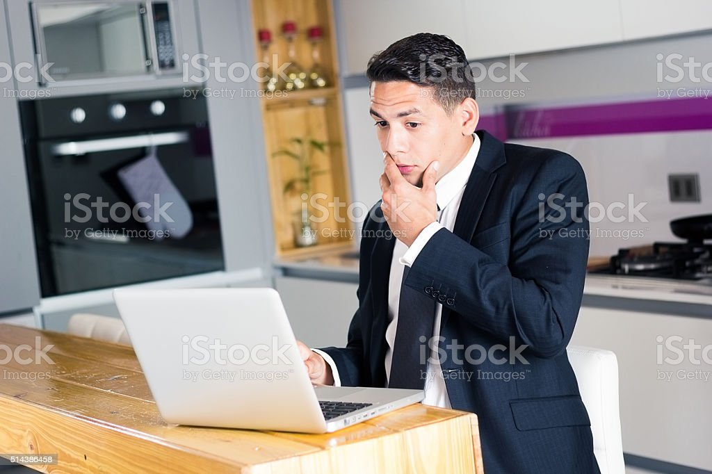 Stressed manager with laptop on the table stock photo