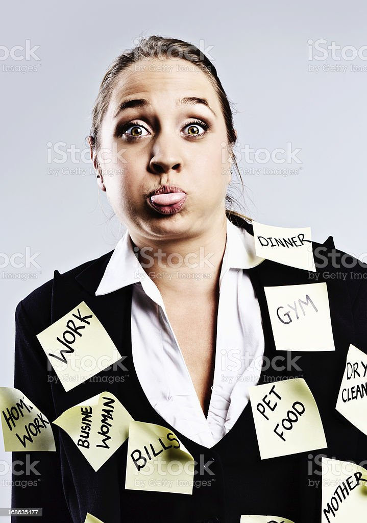 Stressed modern woman is overloaded with  task reminders royalty-free stock photo