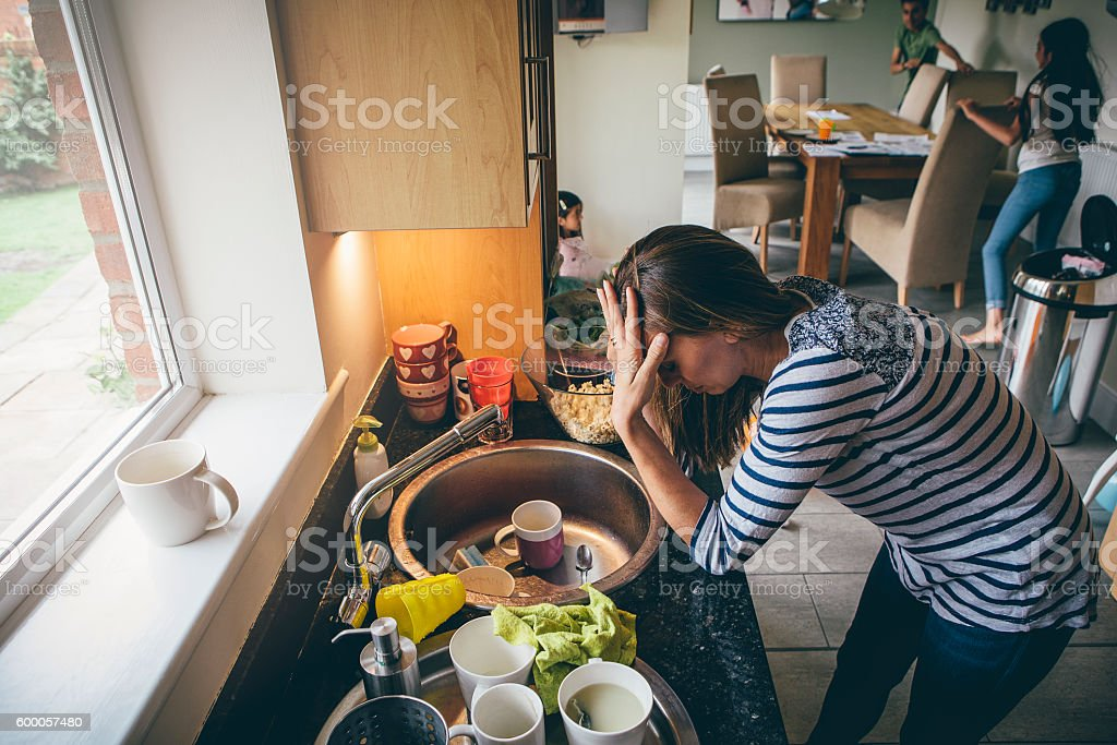 Stressed mother of three stock photo