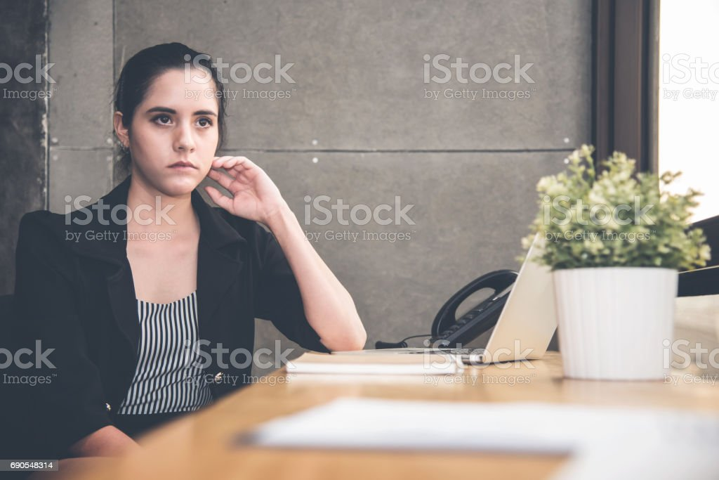 Stressed of Businesswoman on her workplace at the office. stock photo