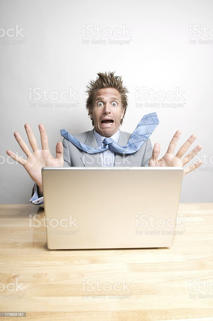 Stressed Office Worker Businessman Panicking at his Computer royalty-free stock photo