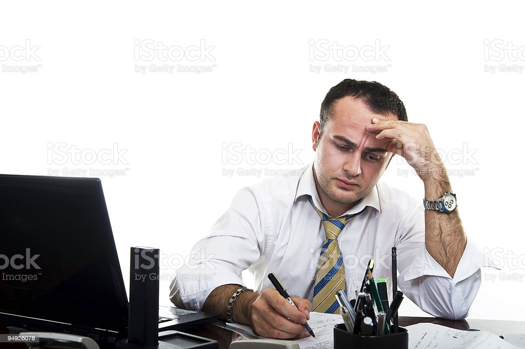 Stressed out businessman struggling with work royalty-free stock photo