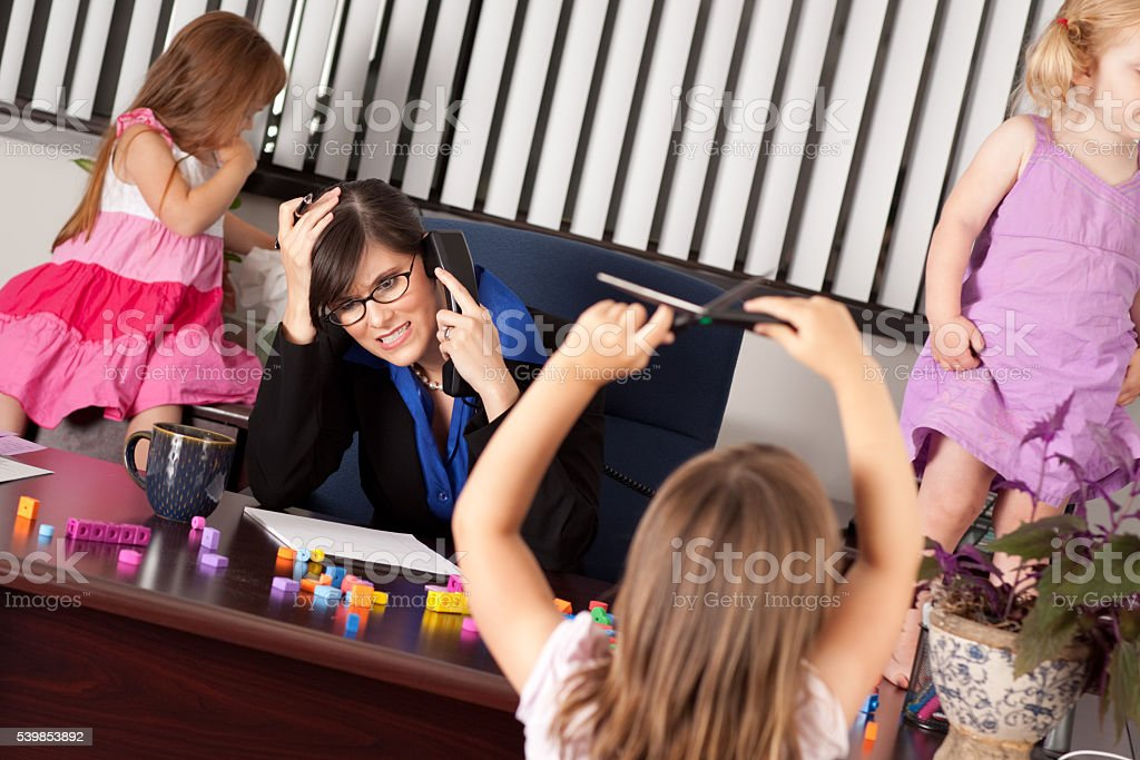 Stressed Out Businesswoman with Children in Office stock photo