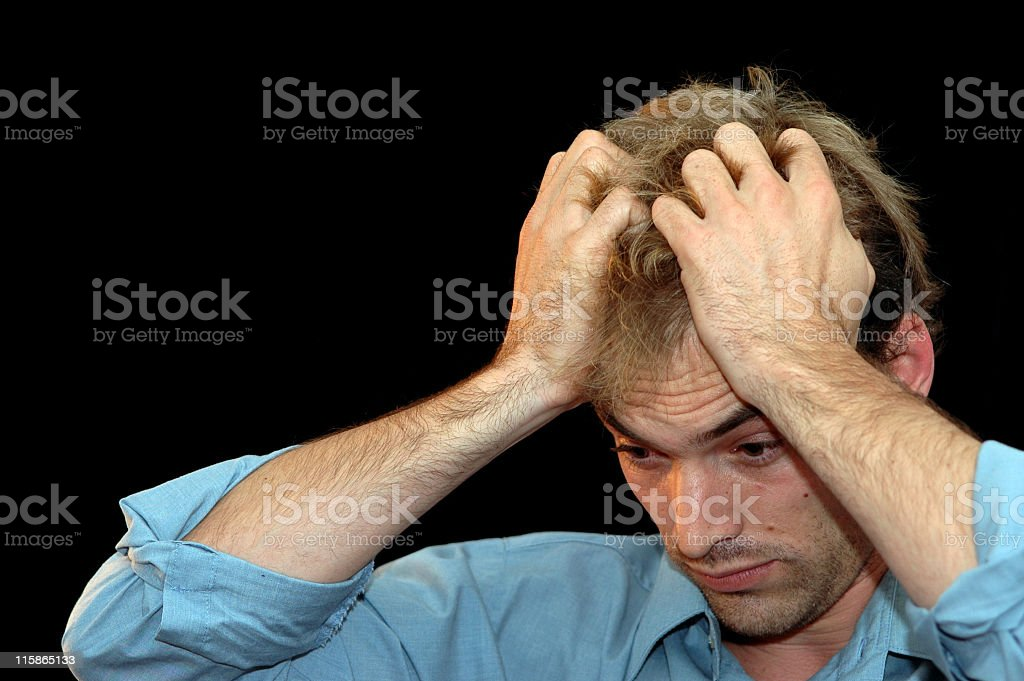 Stressed out man with his hand on his head stock photo