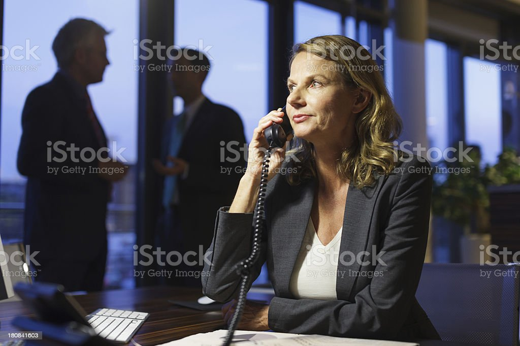 Stressed out Mature businesswoman working late royalty-free stock photo