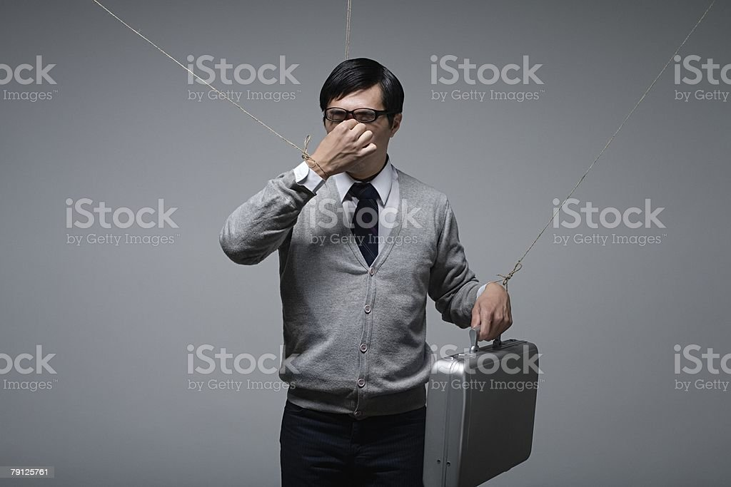 A stressed puppet office worker stock photo