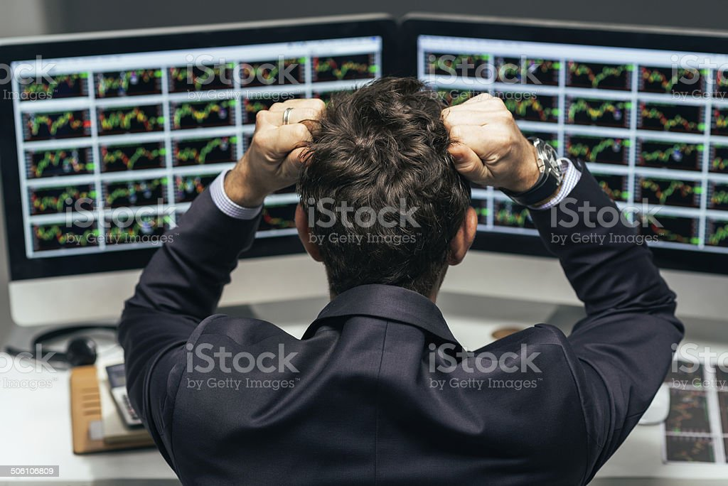 Stressed trader stock photo