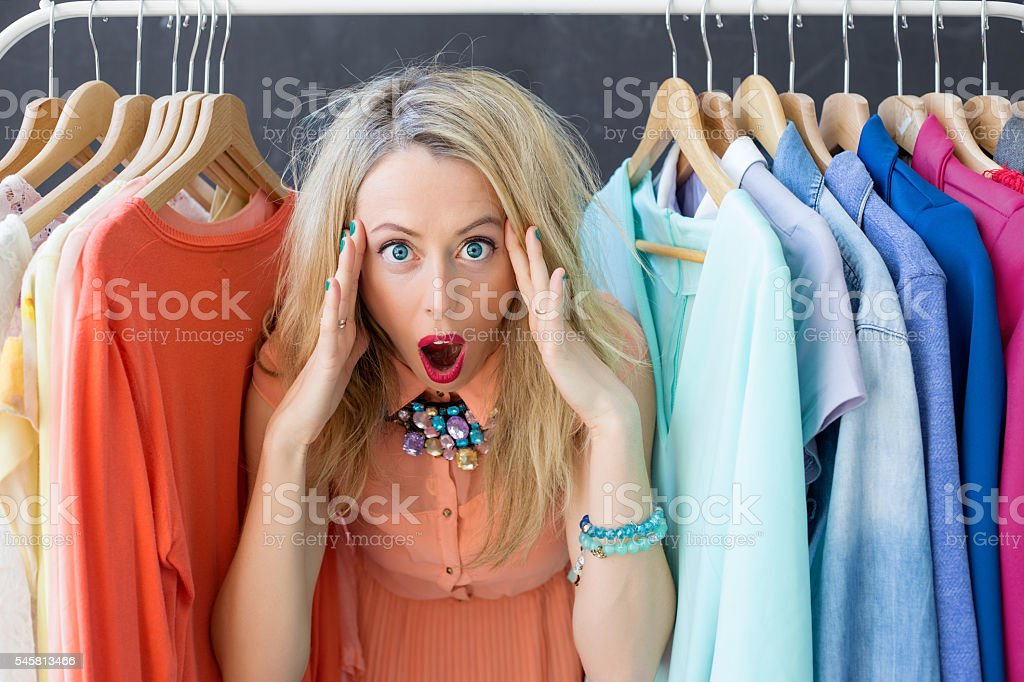Stressed woman deciding what to wear stock photo