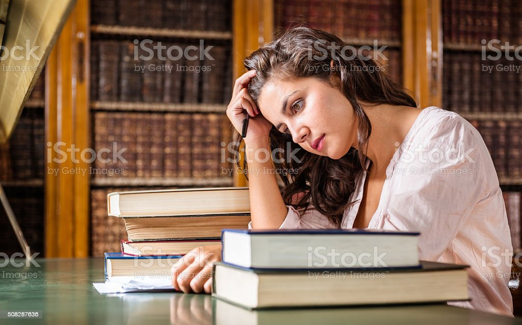 stressed woman during an exams on the classroom stock photo
