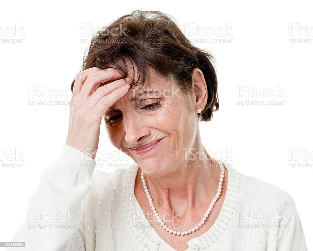 Stressed Woman Rubs Forehead royalty-free stock photo