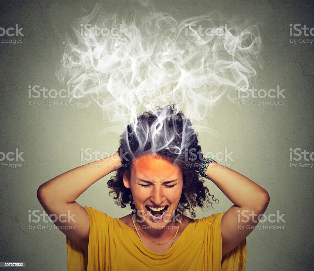 stressed woman screaming frustrated stock photo