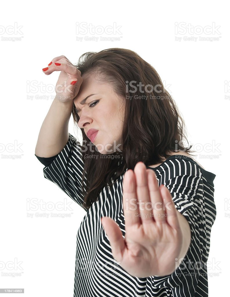 stressed woman showing stop sign stock photo