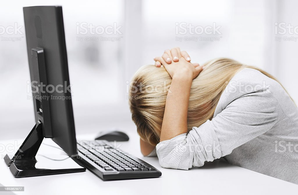 stressed woman with computer in office stock photo
