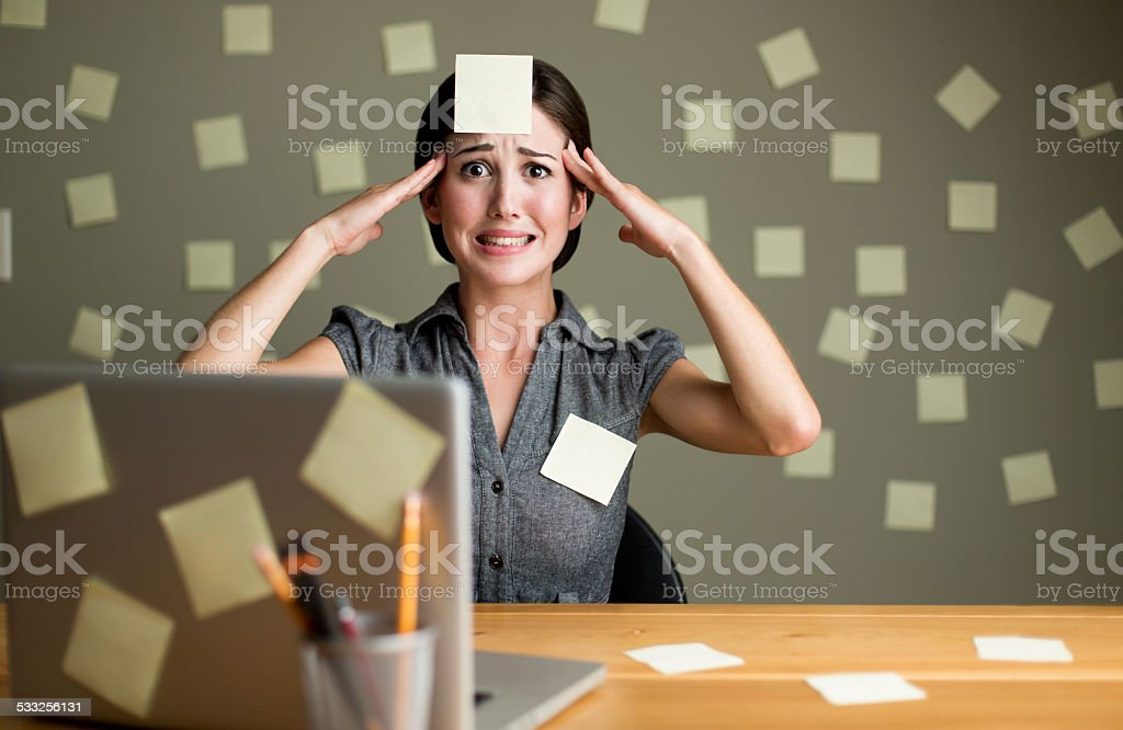 Stressed woman with post its stock photo