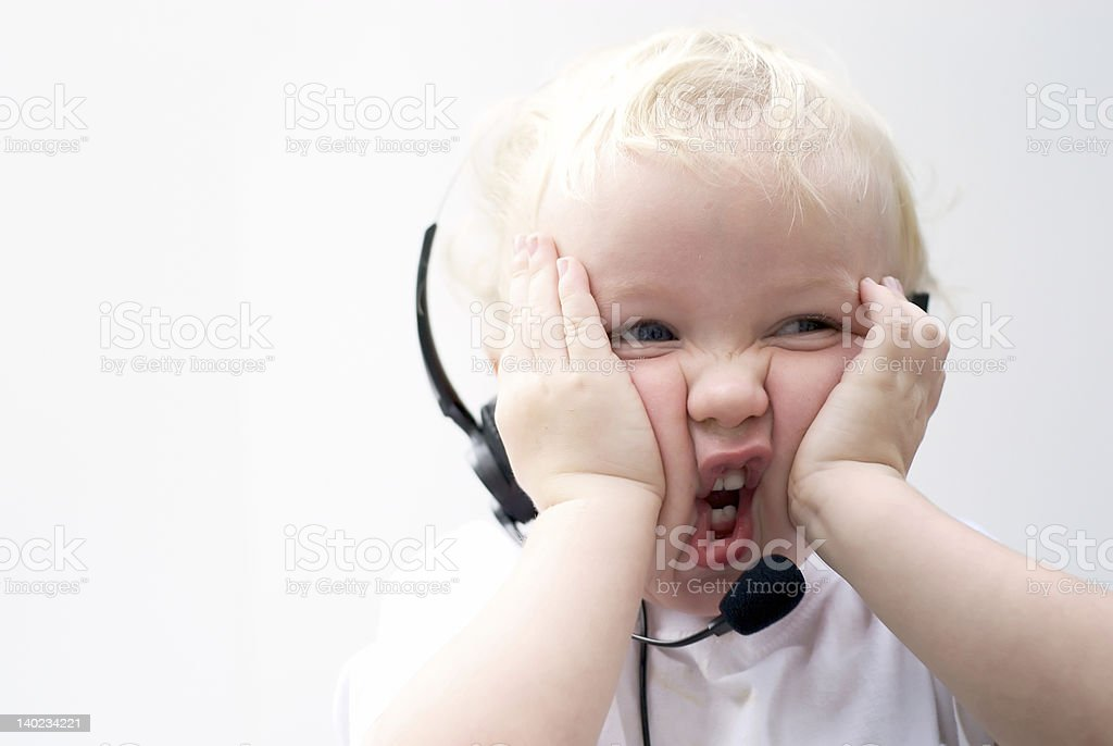 stressed young boy with headset stock photo