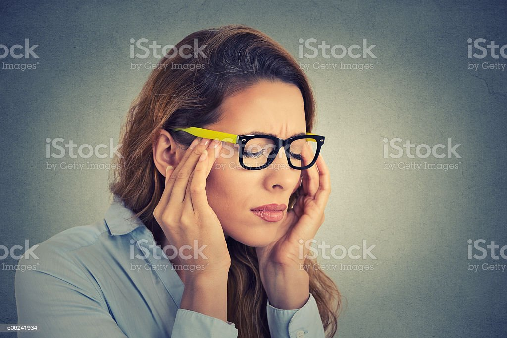 Stressed young business woman having headache stock photo