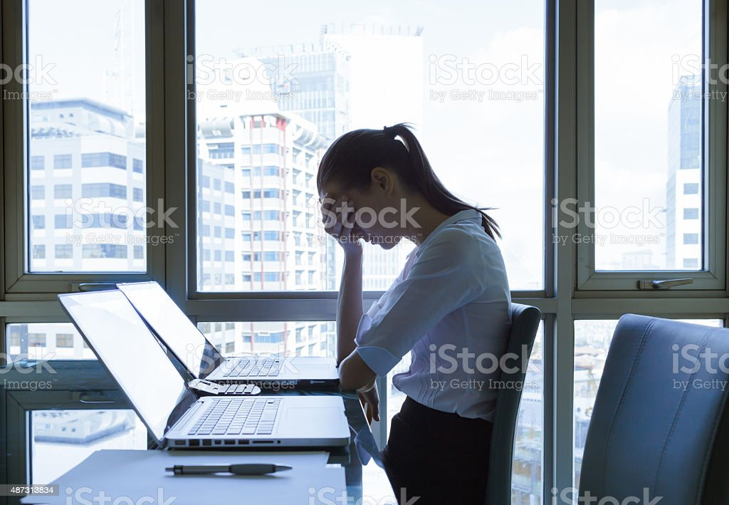 Stressed young businesswoman stock photo