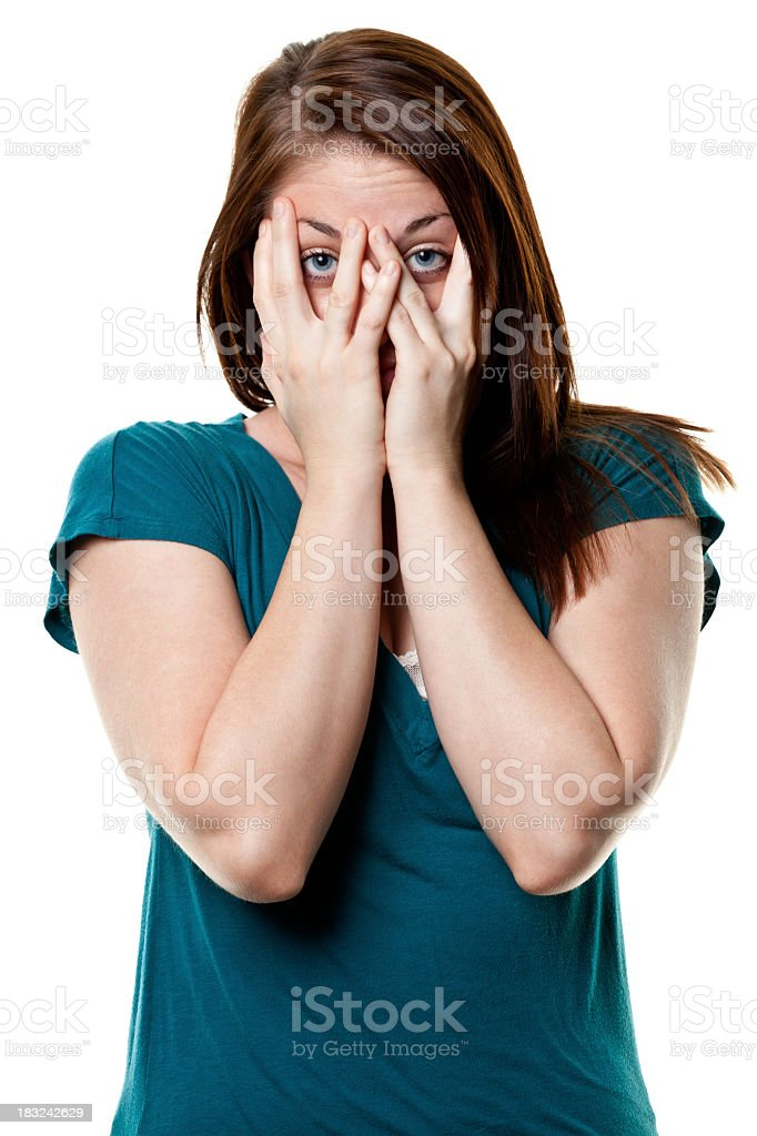 A stressed young woman covering her face with her hands royalty-free stock photo