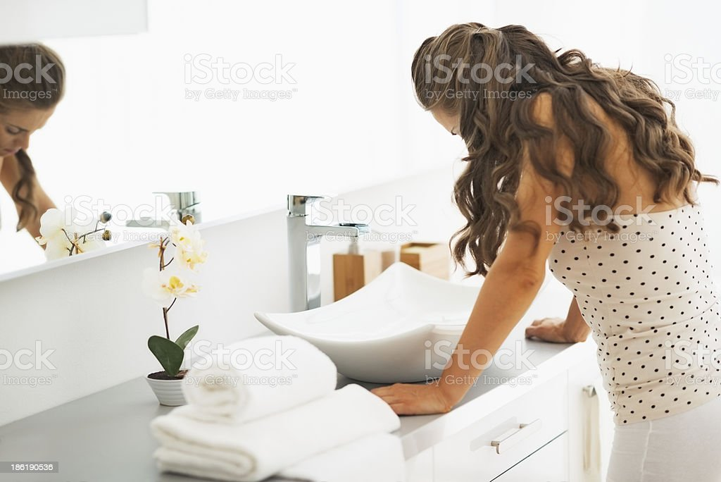 Stressed young woman in bathroom stock photo
