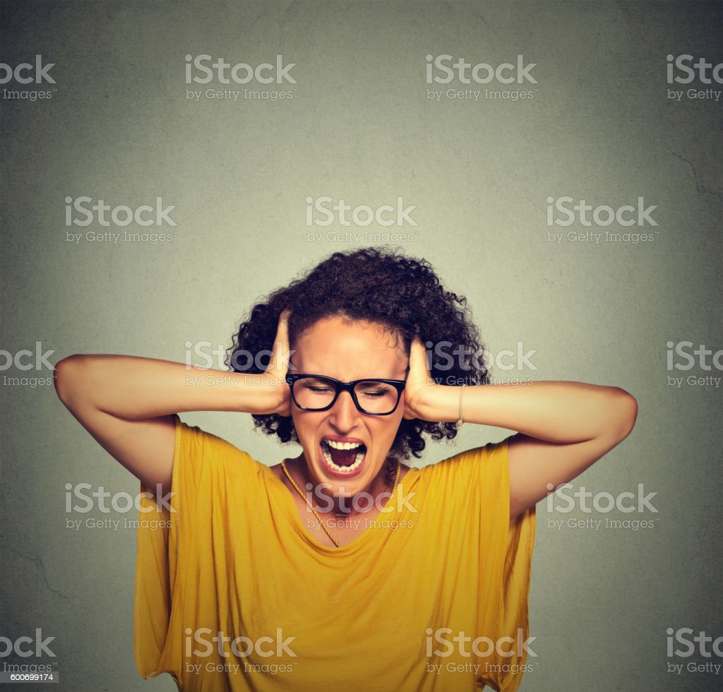 Stressed young woman screaming stock photo