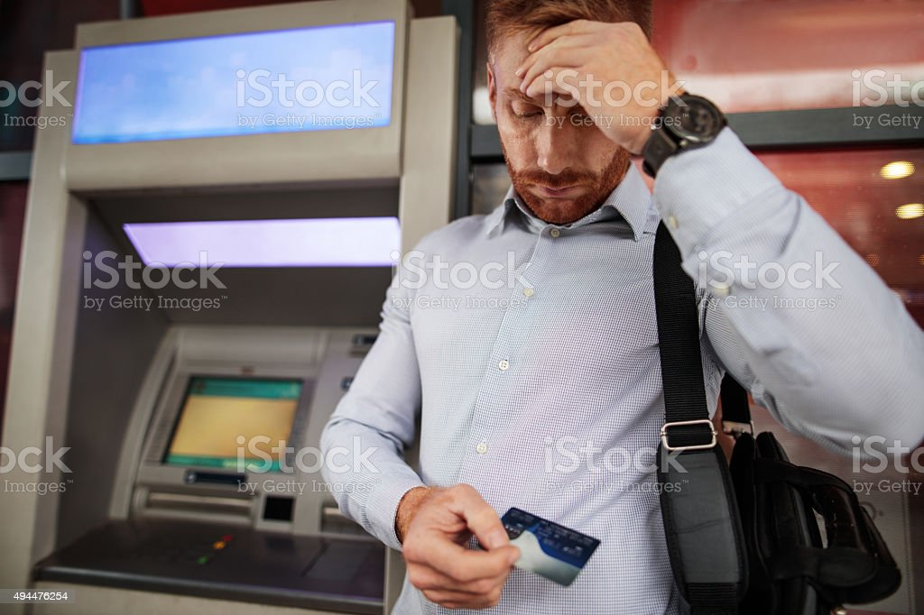 Stressful businessman doesn't have enough money on his credit ca stock photo