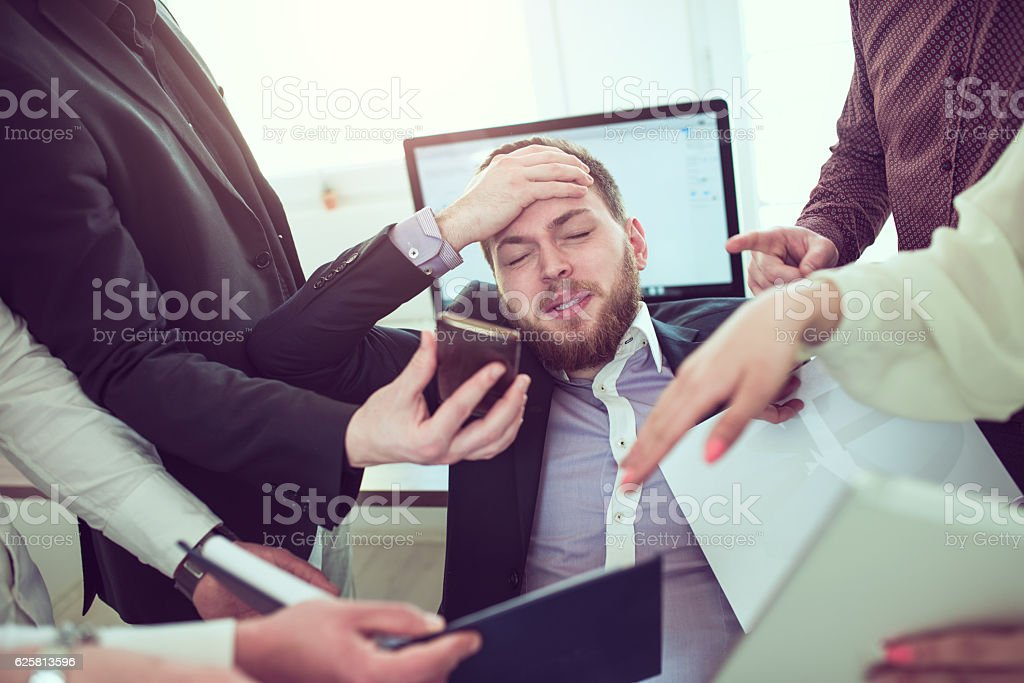 Stressful Businessman with Headache when Receiving Many Complaint and Issue stock photo