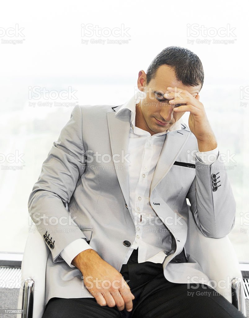 Stressful mid adult businessman. royalty-free stock photo