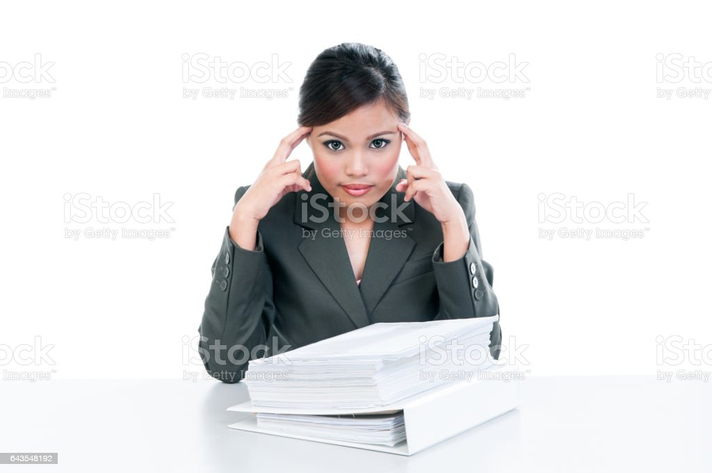 Stressful young businesswoman thinking stock photo
