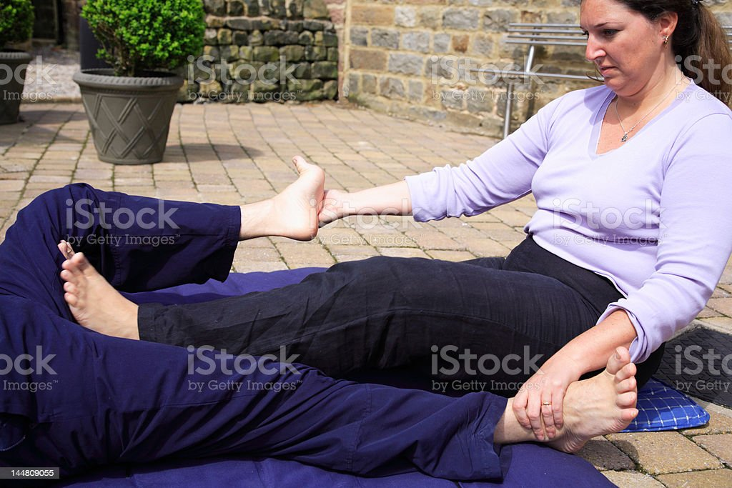 Stretch to the inner thigh stock photo