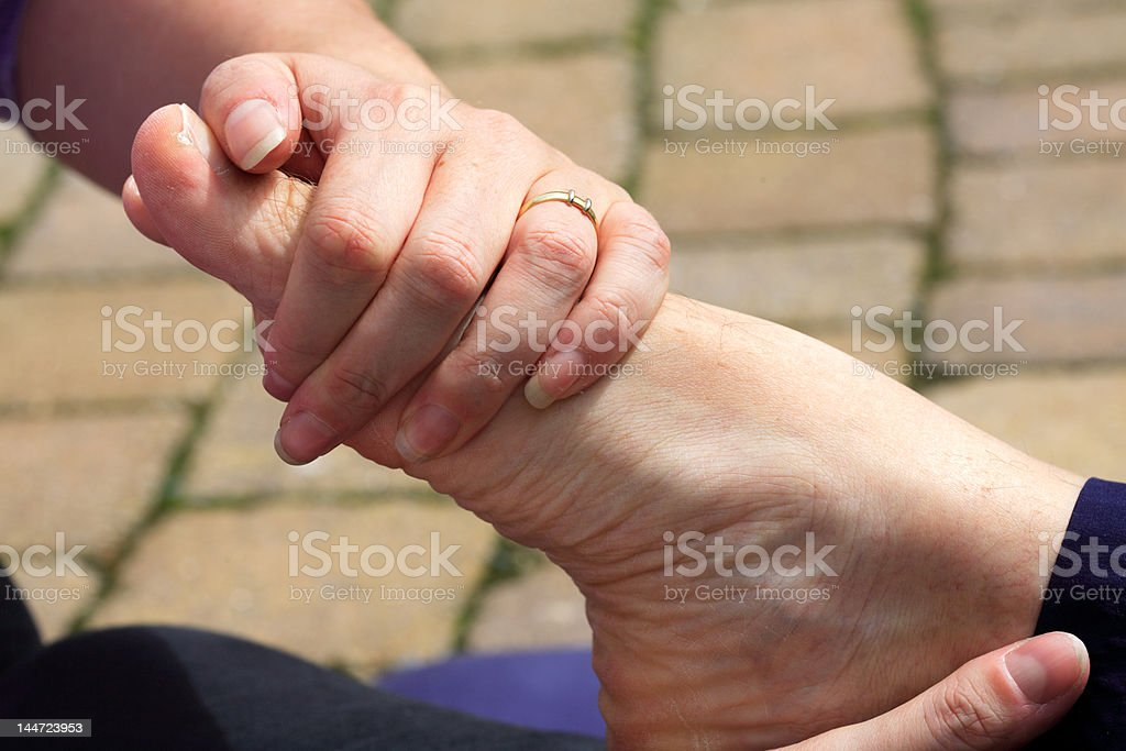 Stretch to top of the foot stock photo