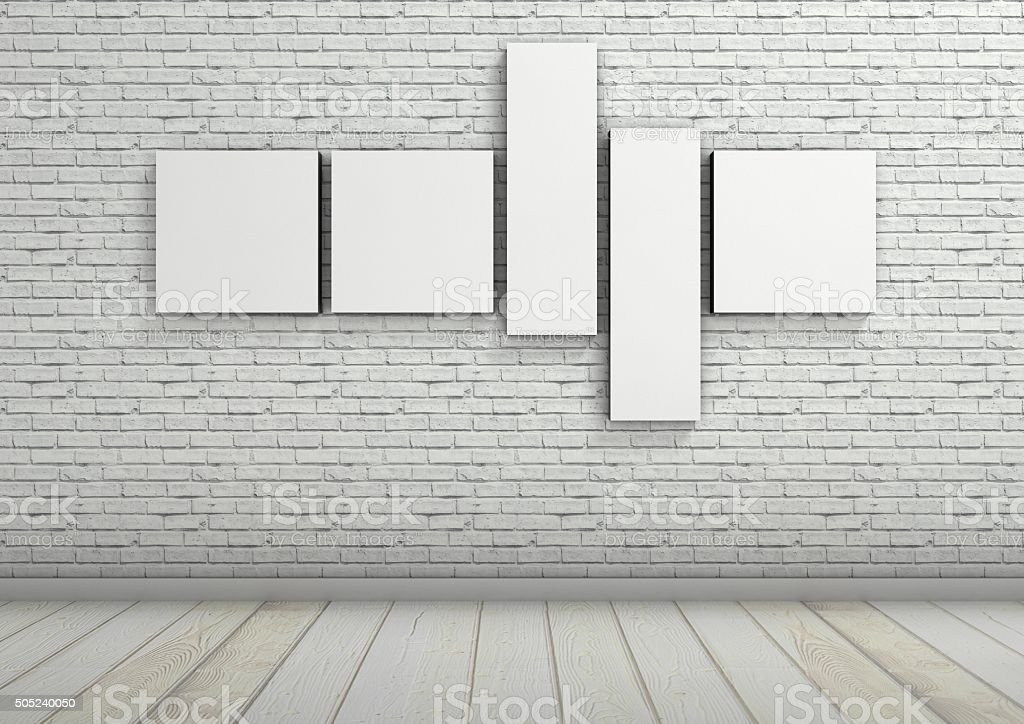 Stretched canvas composition on white brick wall, architectural interior stock photo