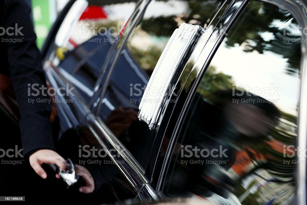 Stretched Limo & Chauffeur stock photo